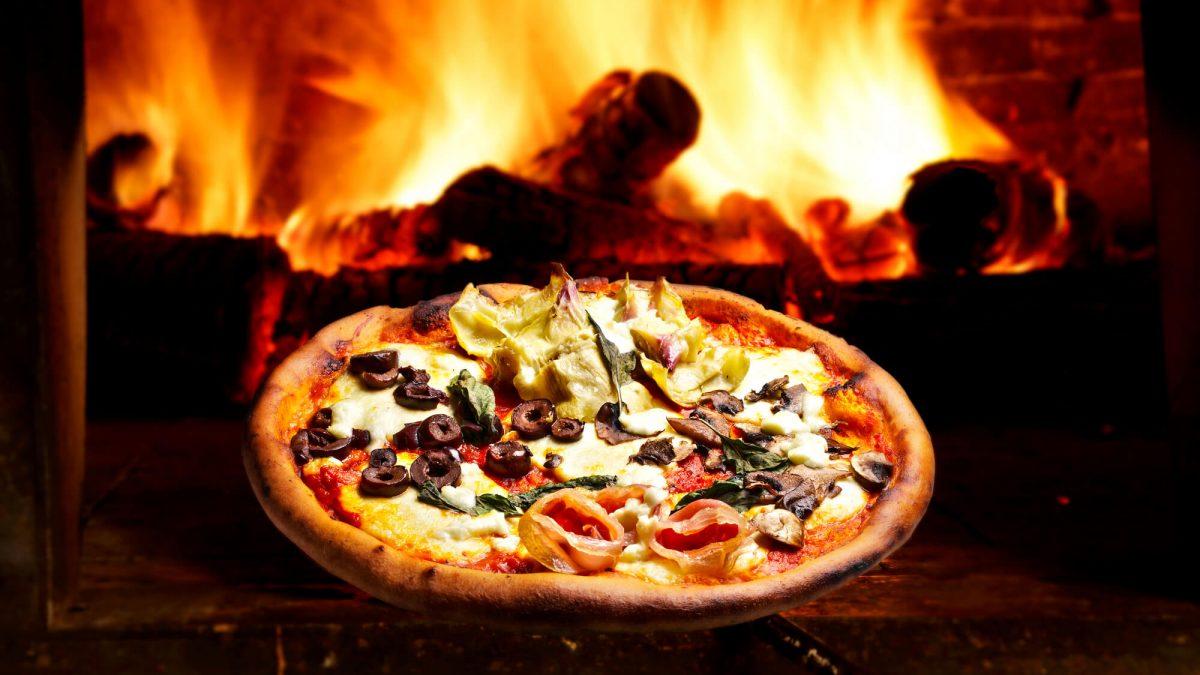 Entenda as vantagens e desvantagens do forno a lenha para sua pizzaria
